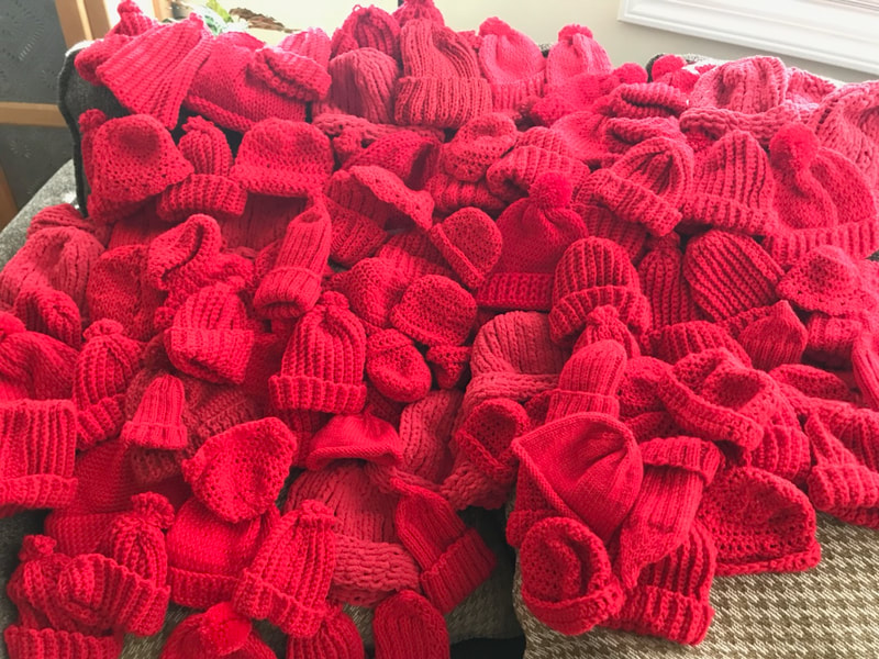 Over 100 Red Hats made by MARTA members